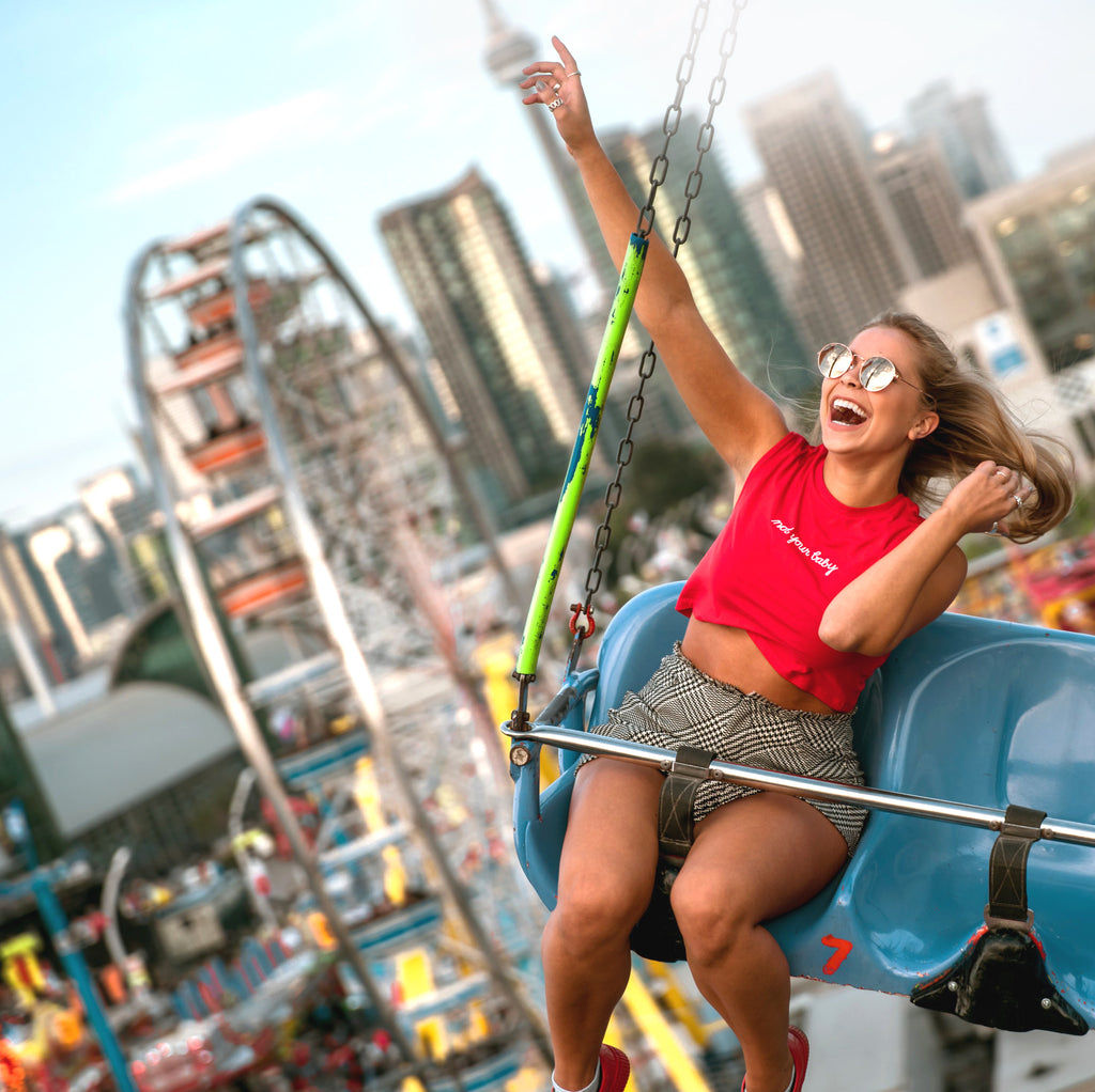 woman having fun on carnival ride