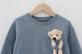 Alex + Nova Dolly Pocket Bear Sweatshirt - Alex + Nova