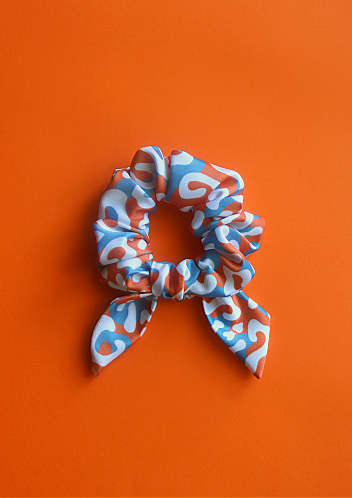 Orange leopard bow scrunchie