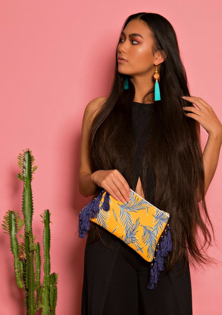 Navy leaves tassel clutch