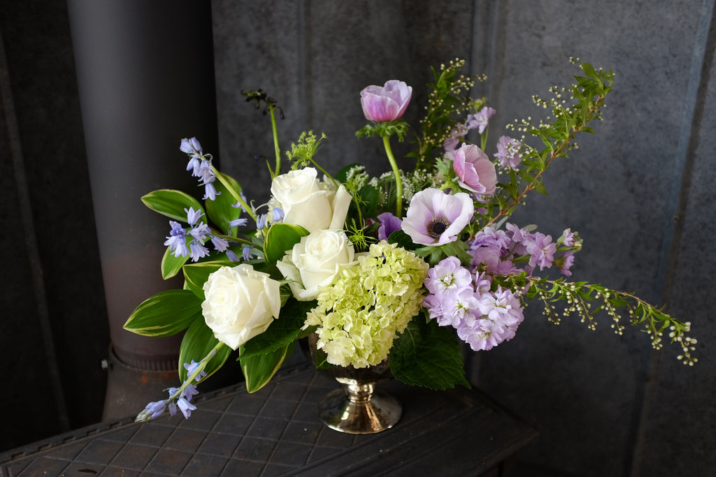 Alcott Flower Design iwth Solomon Seal, Spanish Blue Bells and Anemones by Michler's Florist