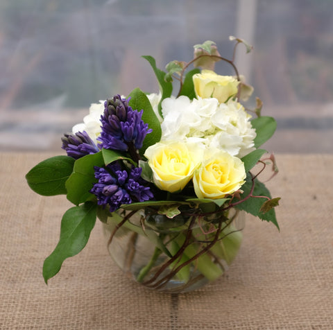 Andover Flower Arrangement: Yellow Sweetheart Roses, Hydrangea, Blue Hyacinth, and Ivy Vines.  Designed by Michler's Florist in Lexington, KY