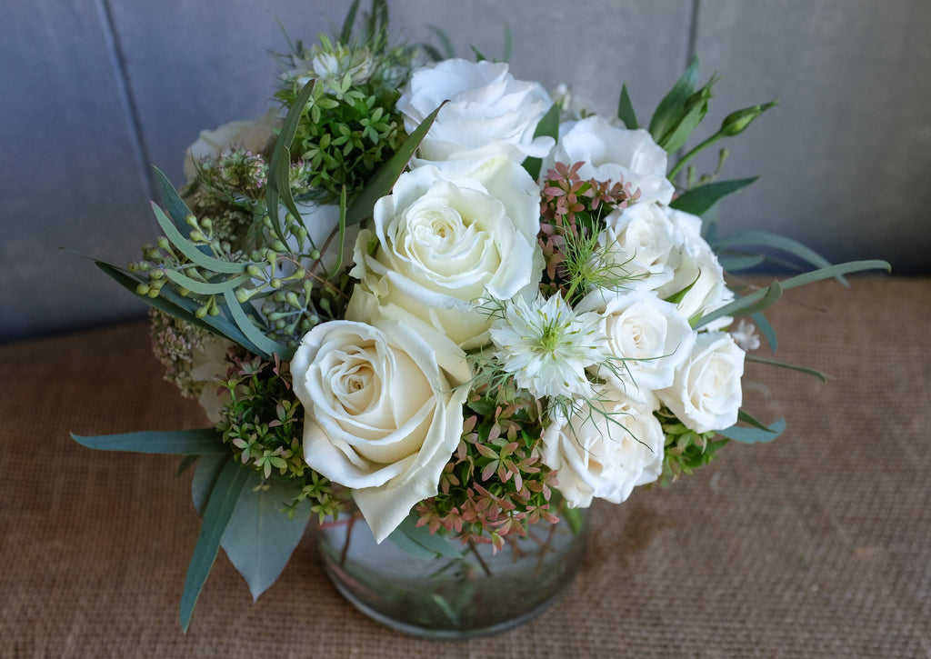 contemporary floral bouquet with white roses, hydrangea, lisianthus and autumnal seasonal accents