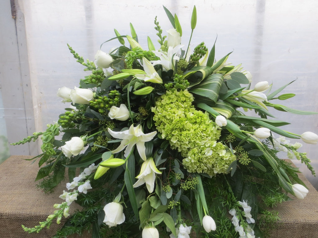 Casket Spray with Green Hydrangea, White Lilies, Roses, and Tulips. Michler's Florist