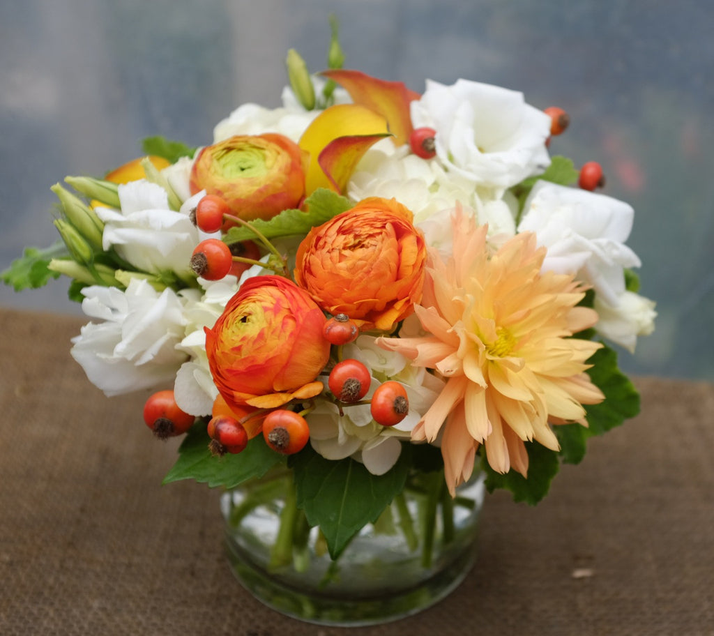 Bellcastle: Flower design with orange Dahlia, Ranunculus, Calla Lilies and White Lisianthus | Michler's Florist