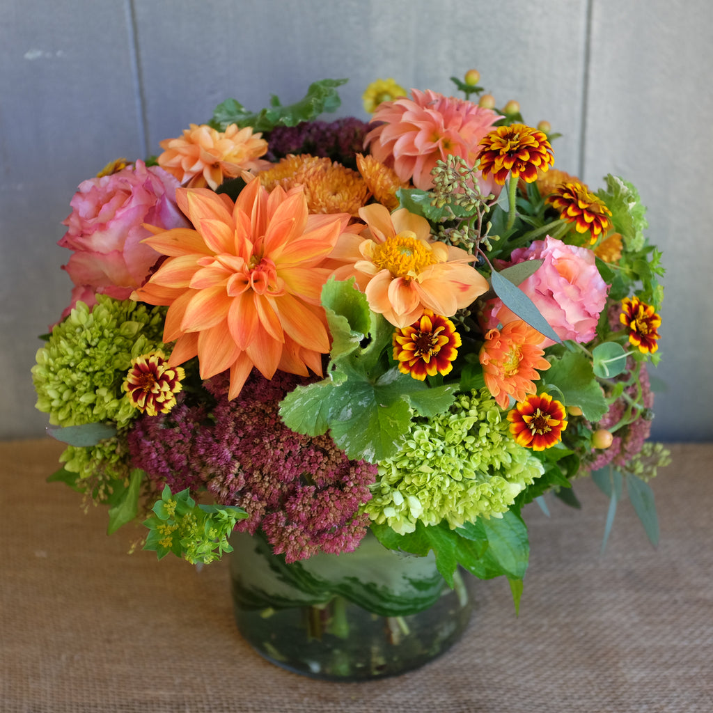 Bright and cheery flower arrangement by Michler's