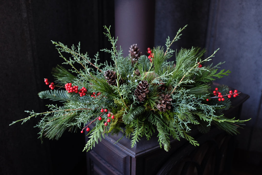 Woodland Centerpiece with moss, berries, pine cones and cedar.