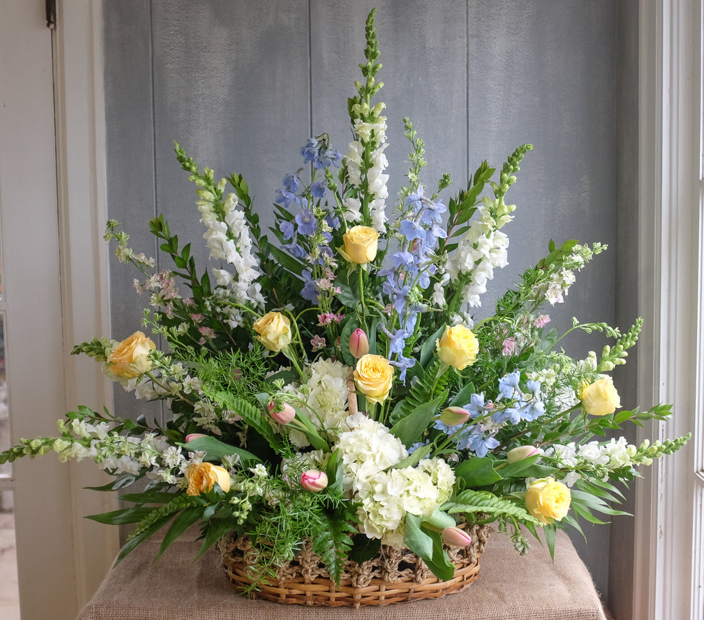 flower basket with roses, hydrangea, larkspur, and stock by Michler's Florist in Lexington, KY