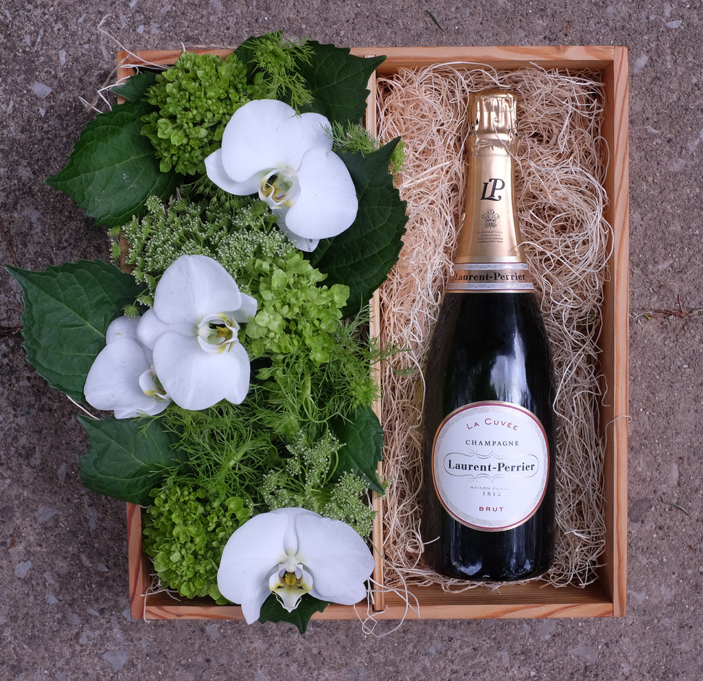 Champagne wine gift crate with orchid flowers