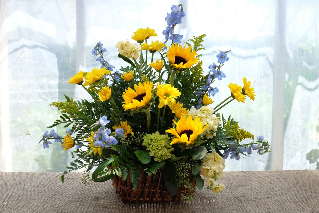 Funeral Flower Basket with Sunflowers and Delphinium | Michler's Florist