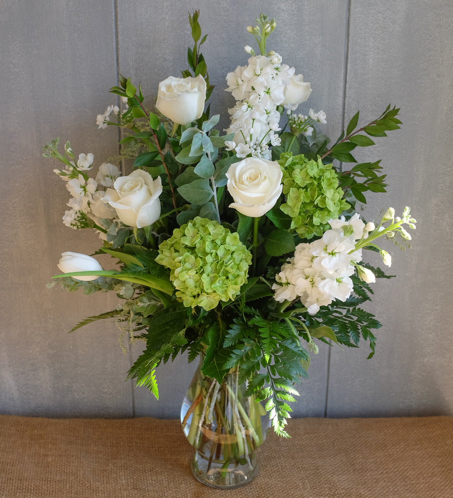 White and green flower bouquet by Michler Florist.