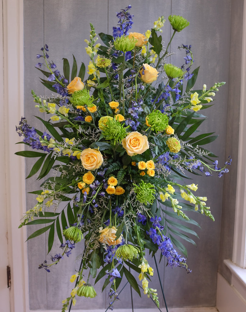floral easel spray with roses, larkspur, and stock by Michler's Florist in Lexington, KY