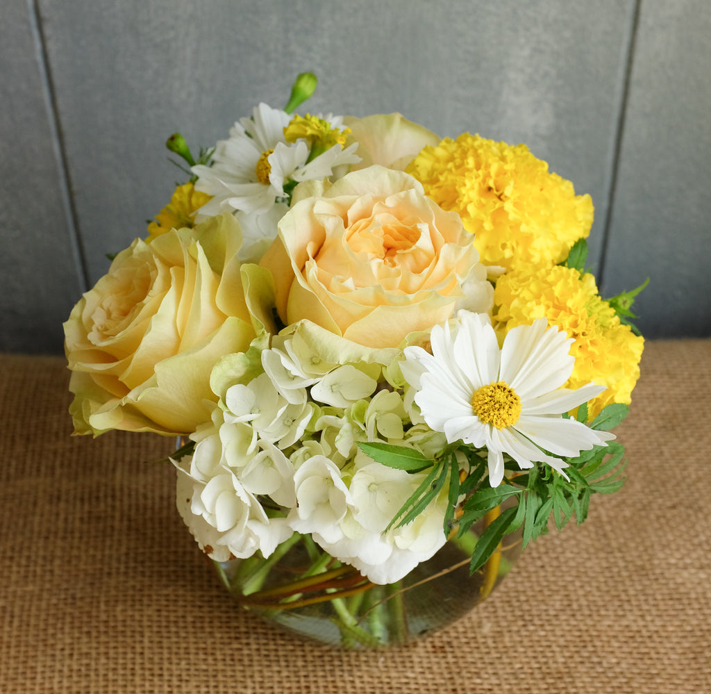 Yellow and white flower bouquet by Michler florist.