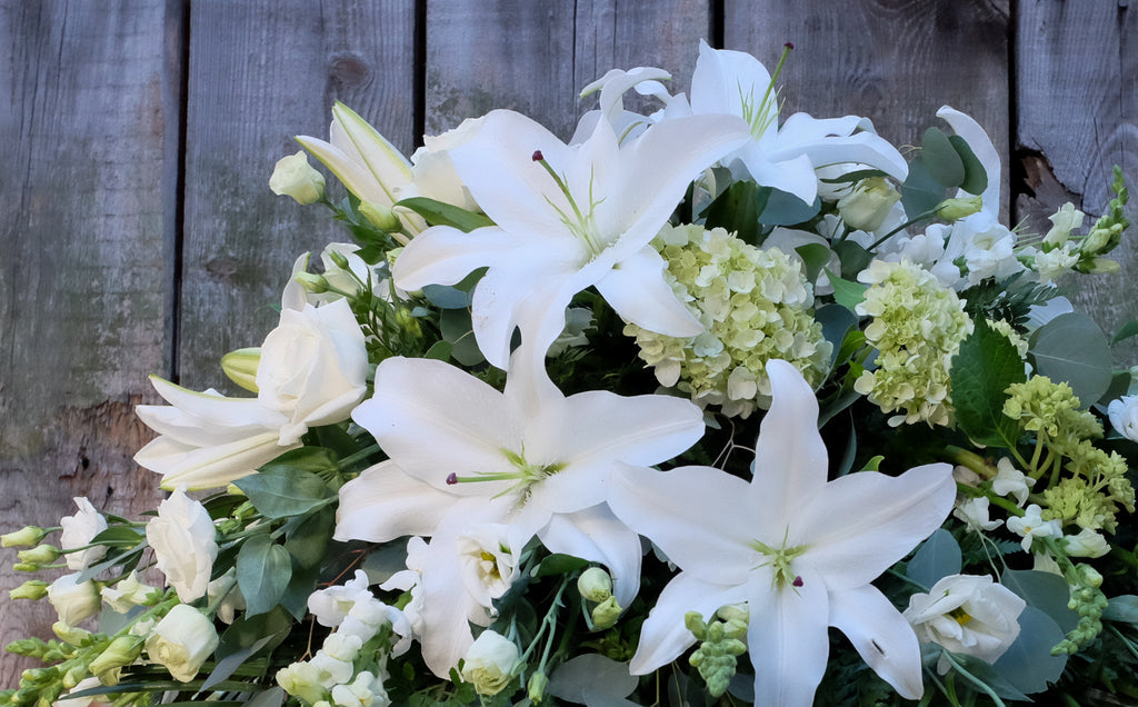 Example of all white casket spray.  Michler's Florist, Greenhouses & Garden Design