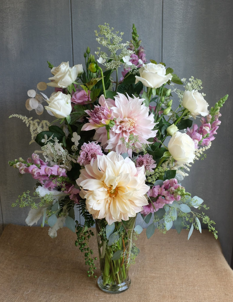 Floral arrangement with dahlias, astilbe, white roses, pink snapdragon by Michler's Florist