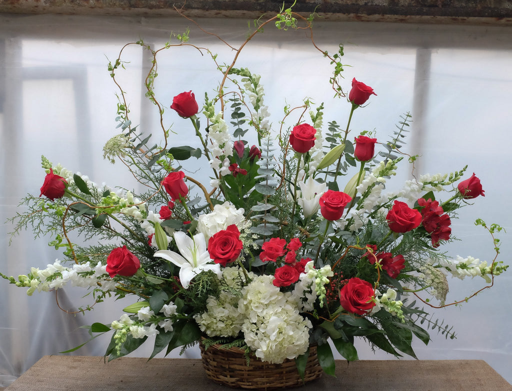 Floral arrangment with red roses, white snapdragons, white lilies, white hygrangea by Michler's Florist