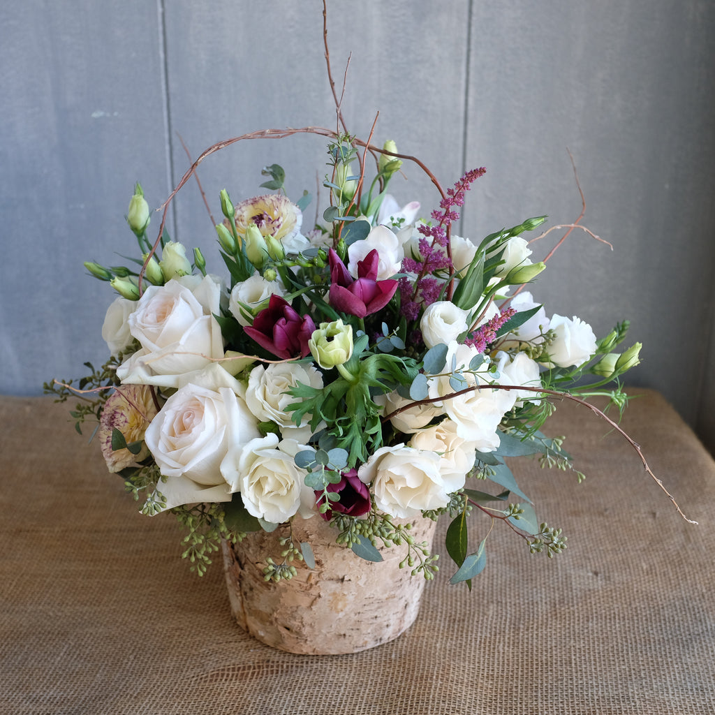 white roses, ranunculus, curly willow floral design by Michlers Florist