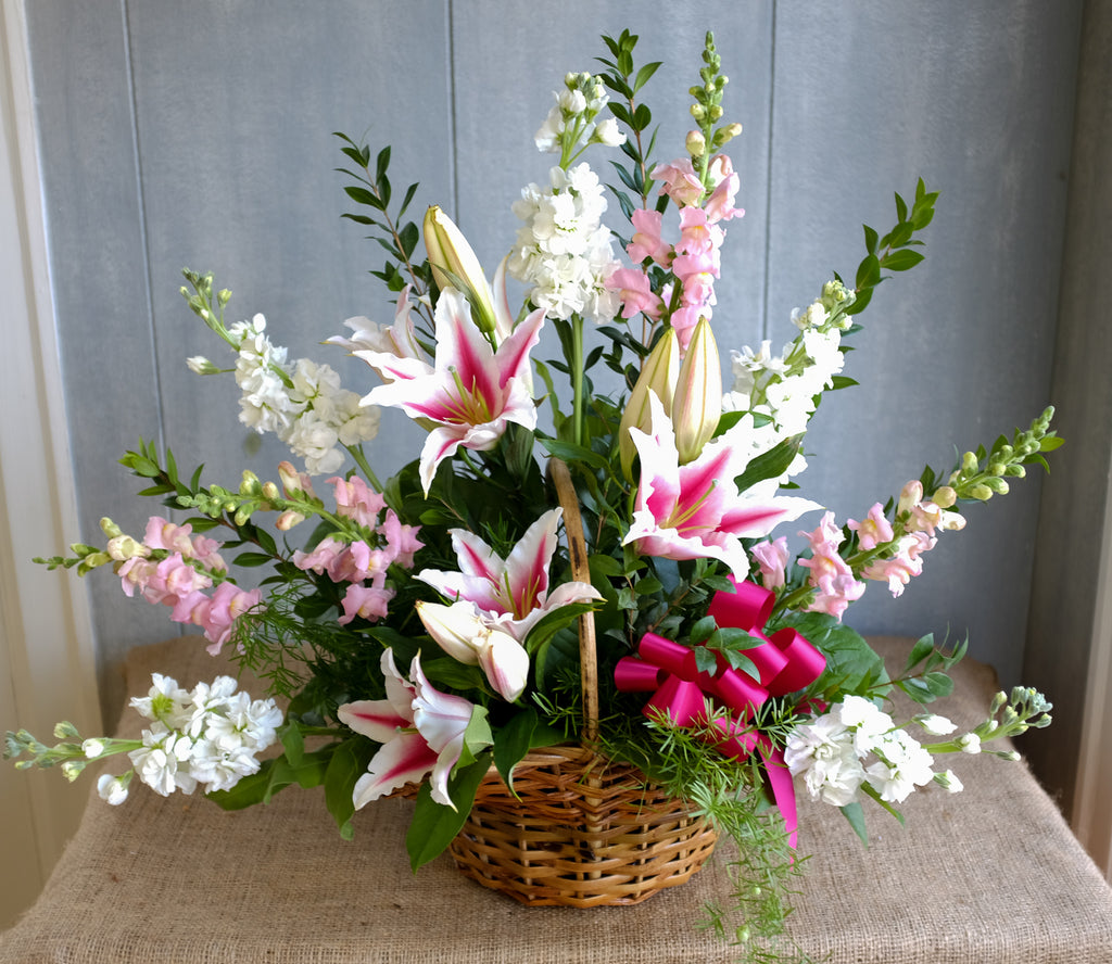 Funeral Basket arrangement by Michler's Florist with star gazer lilies, pink snapdragon, white snapdragon