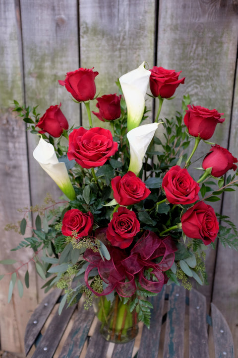 Red roses and white calla lilies designed in Lexington, KY by Michler's Florist