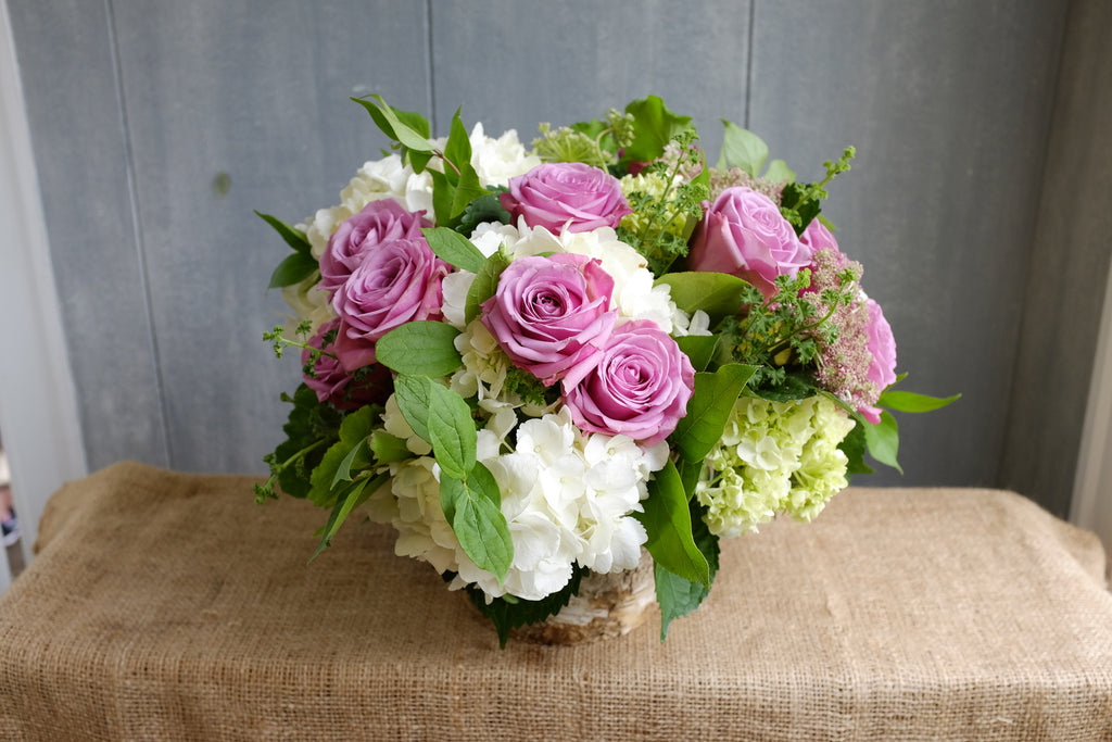 Floral Arrangement by Michler's Florist with pink roses and white hydrangeas