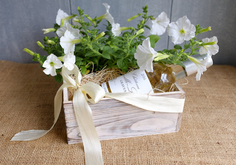 White petunias and white wine gift crate Michler's Florist