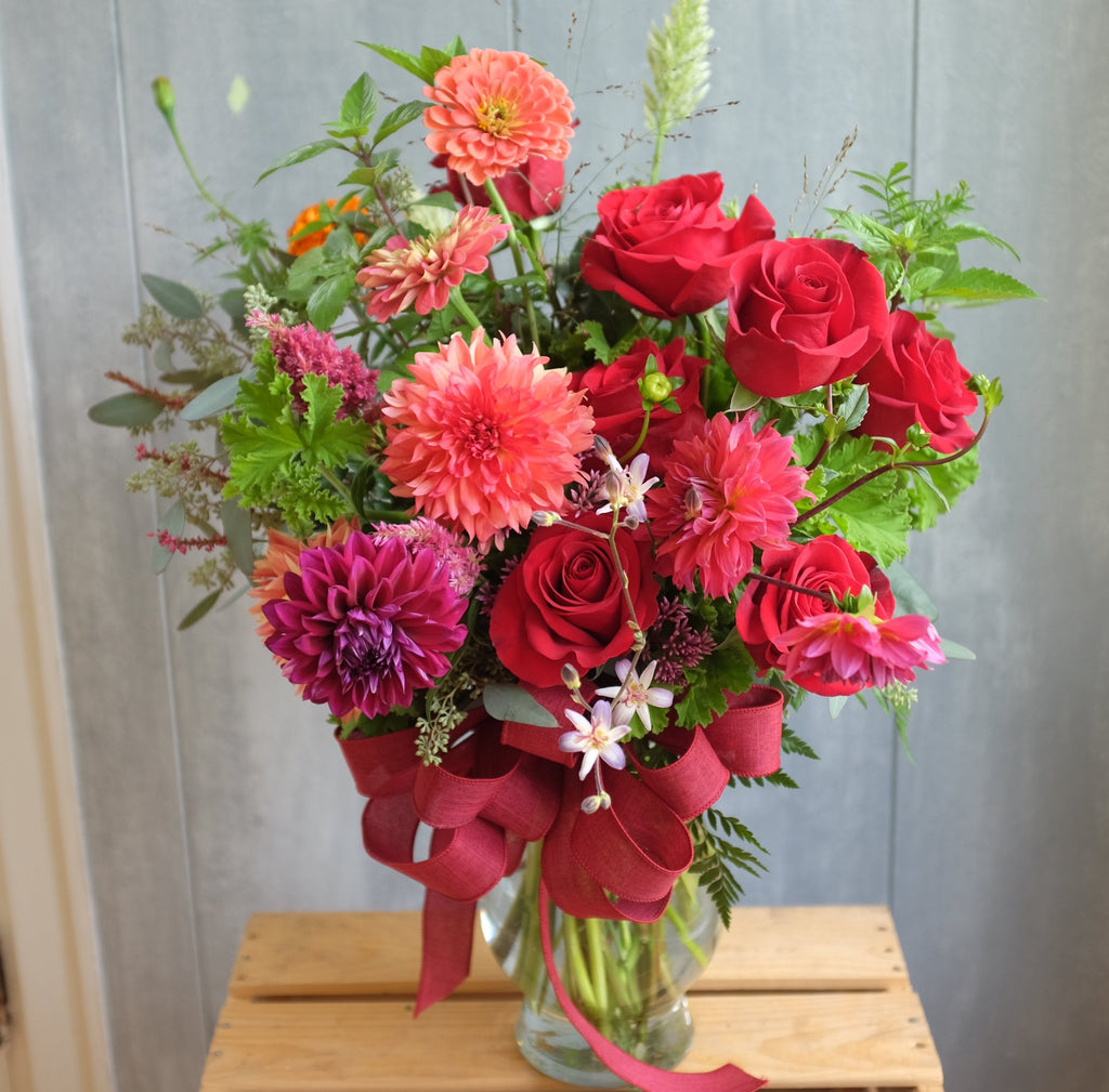 Fairhaven: Red Roses and Dahlias in a vase arrangement