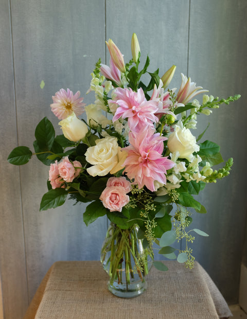 Lovell floral design with blush Dahlias, white and pink roses and stargazer lilies.  Designed by Michler's Florist in Lexington, KY