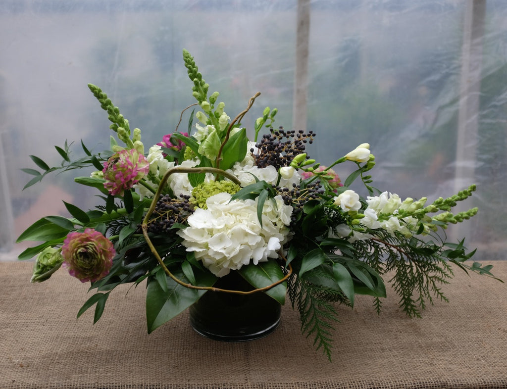 Floral Centerpiece with Ranunculus, Privet Berry, Snapdragons , Freesia, and Hydrangea | Michler's Florist