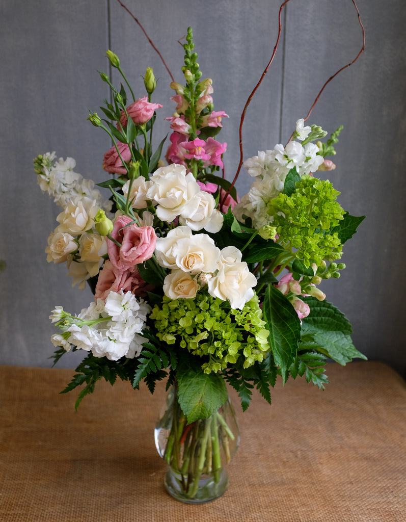 Flower arrangement with Lisianthus, Roses, Snapdragons, Stock and Hydrangea