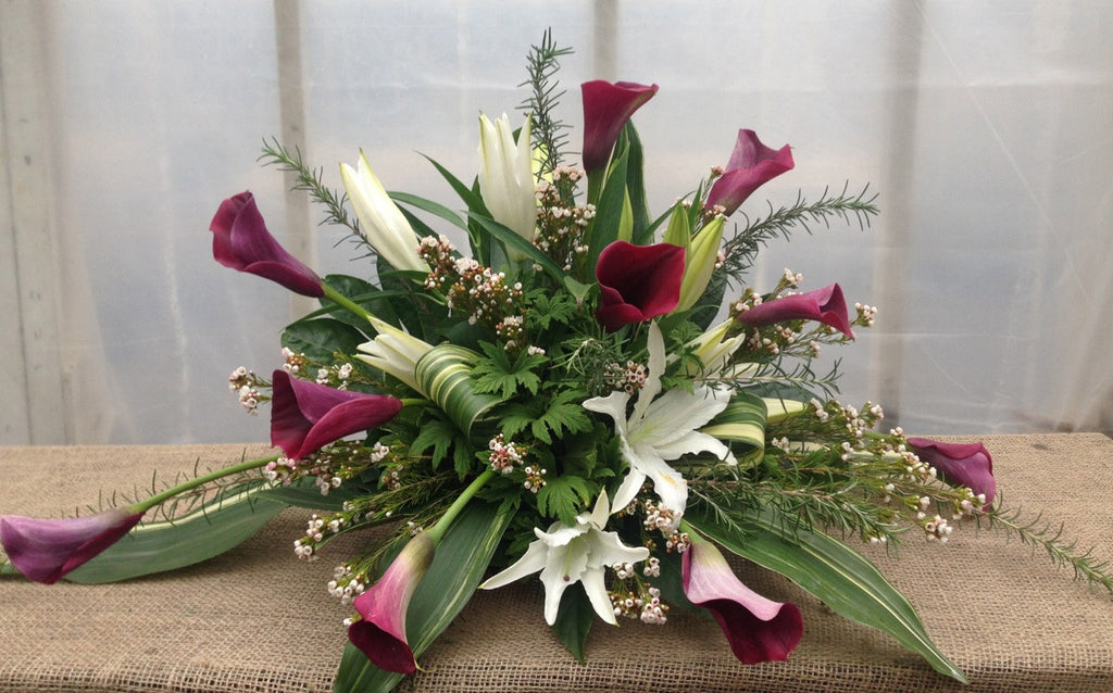 Edinborough: Funeral Flowers with Purple Calla Lilies and White Lilies.  Designed by Michler's Florist in Lexington, KY