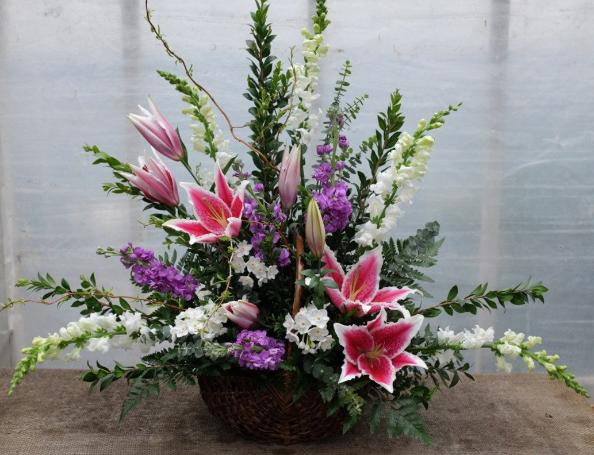 Eldemere Funeral Basket with White Snap Dragons, Stargazer Lilies, and Purple Stock. Designed by Michler's Florist in Lexington, KY
