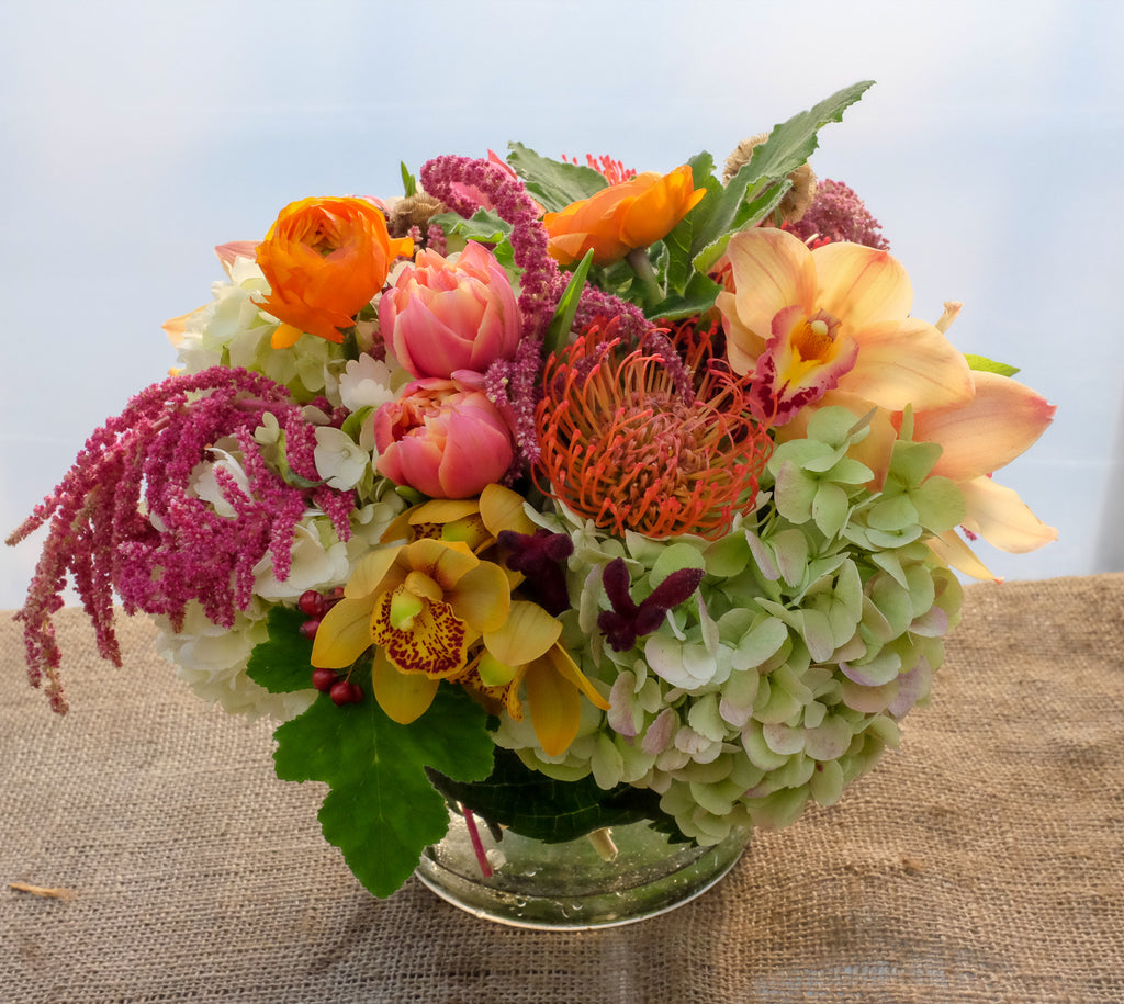 Thanksgiving Centerpiece with Cymbidium Orchids, Double Tulips, Pin Cushion Protea | Michler's Florist