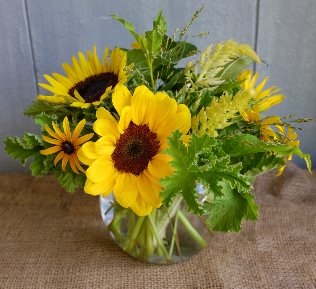Small yellow sunflower bouquet