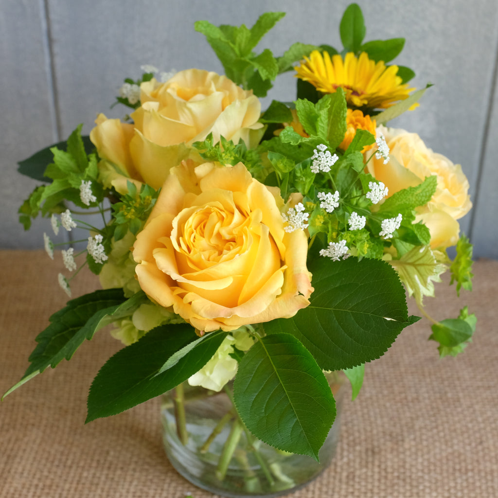 Petite bouquet with yellow roses by Michlers Florist.