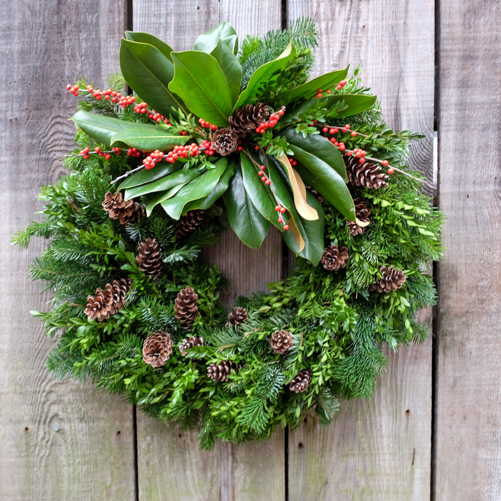Fir and Boxwood Wreath with Pine Cones, Magnolia and Ilex. By Michler's Florist