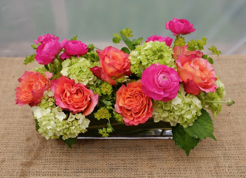 Evora: Floral centerpiece with Ranunculus, Roses, and Hydrangea | Michler's Florist