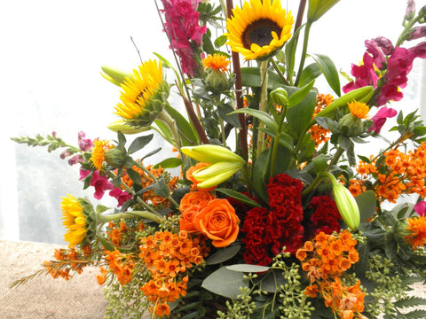Fall Floral Arrangement with sunflowers, safflowers, and celosia