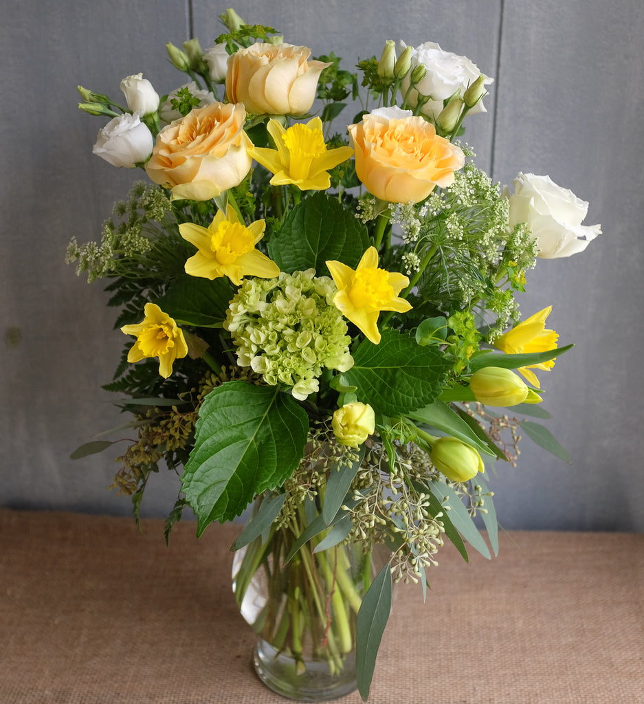 Elegant floral bouquet in white, yellow and green
