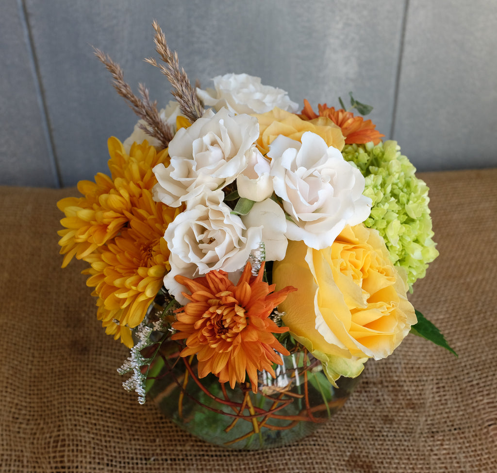 Lush flower bouquet in muted autumn tones.