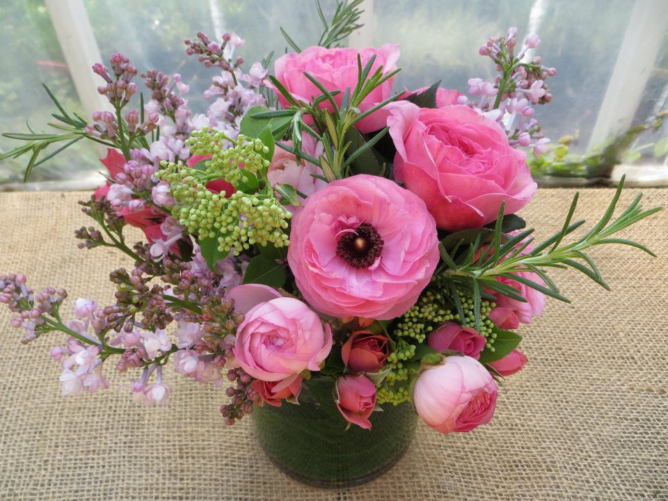 Floral Arrangement of pink roses, pink ranunculus, rosemary made by Michler's Florist