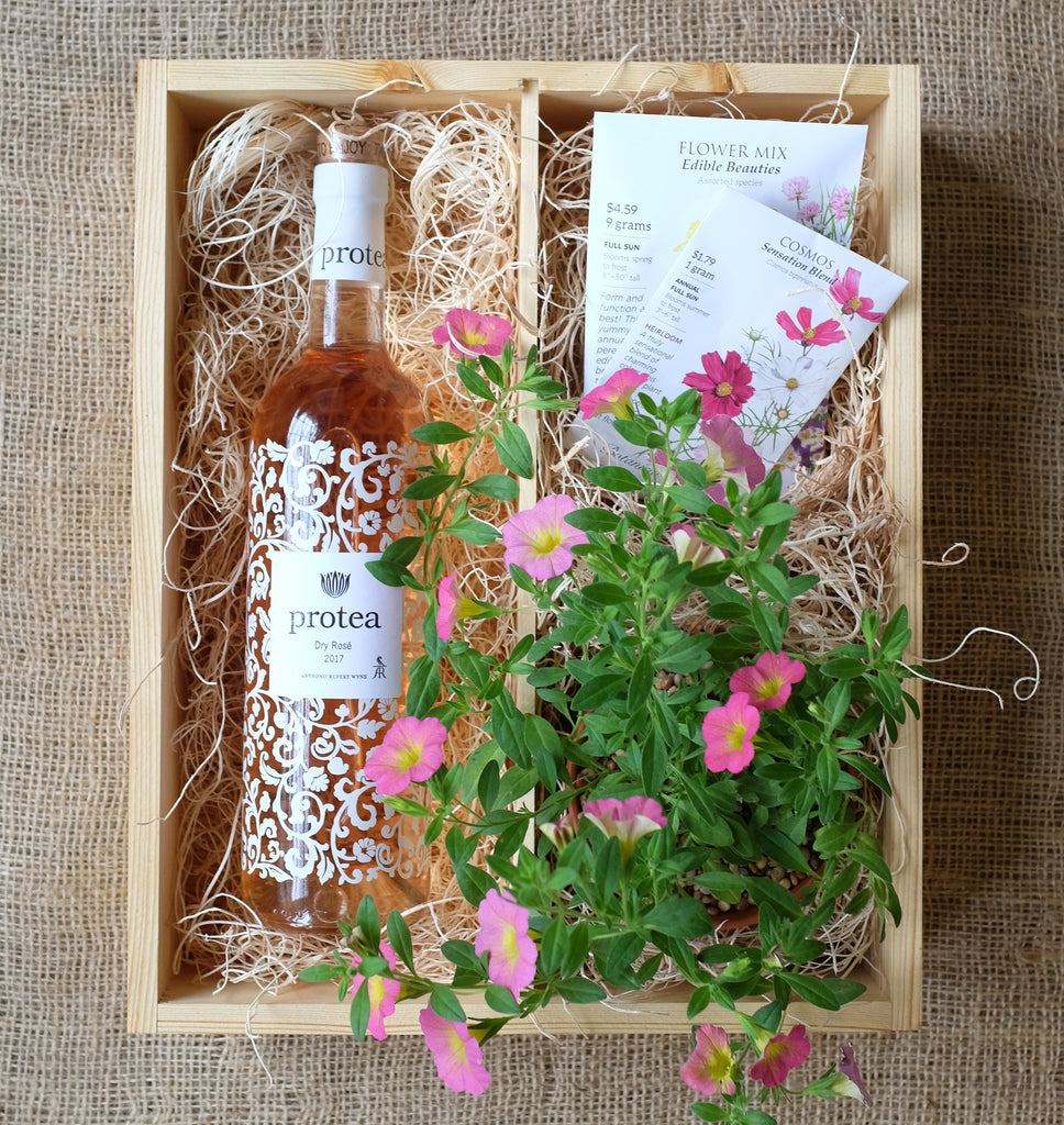 Wooden rose wine box with flowers and seeds