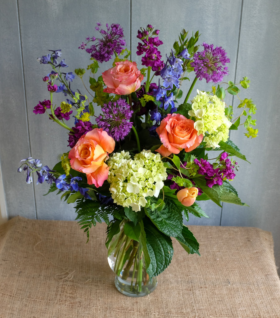 Jersey Flower Design with Alliums, Tulips, and Delphinium by Michler's Florist