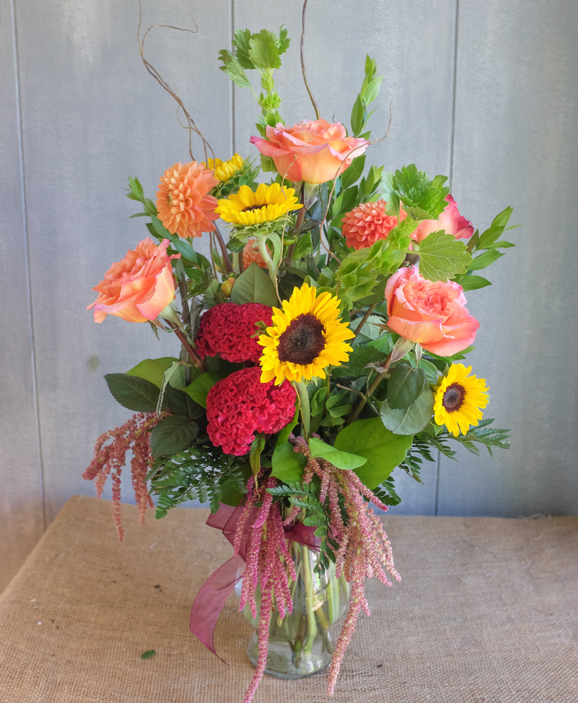 Bright and cheerful bouquet with sunflowers