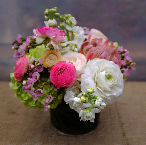 Juneau Bouquet with pink and white Ranunculus and Protea. Designed by Michler's Florist in Lexington, KY