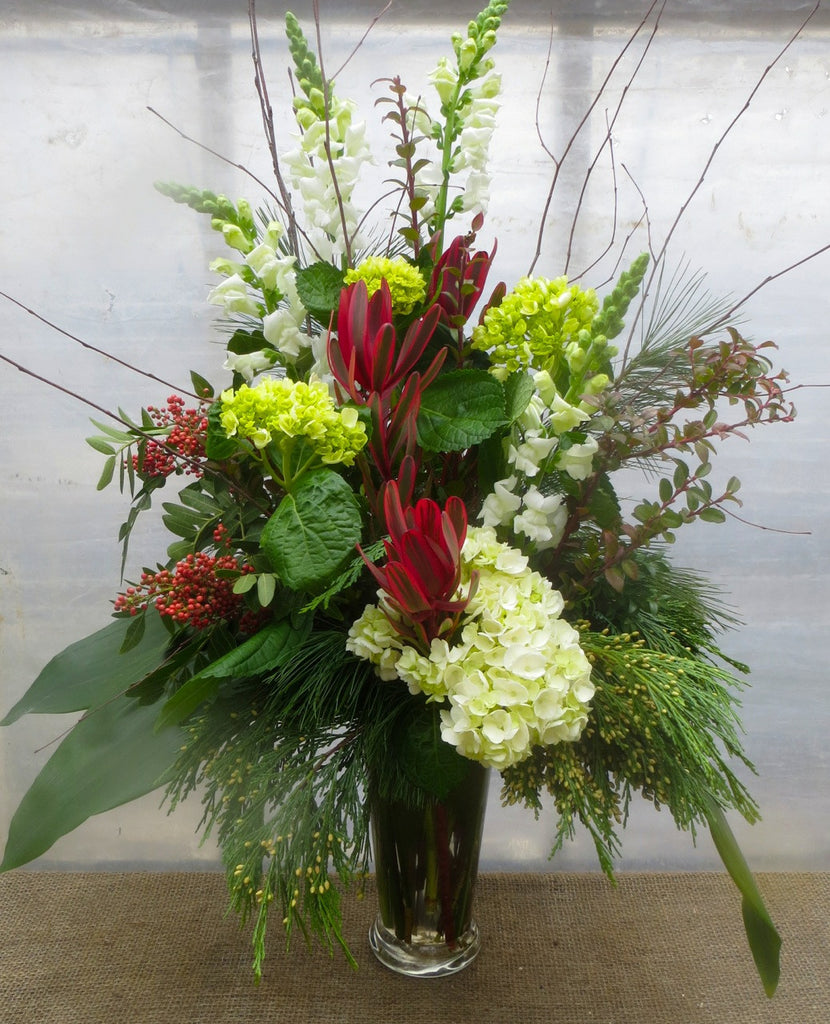 Kingswood: Floral Vase Arrangement with Evergreens, Pepperberries, and Hydrangea. Designed by Michler's Florist in Lexington, Ky