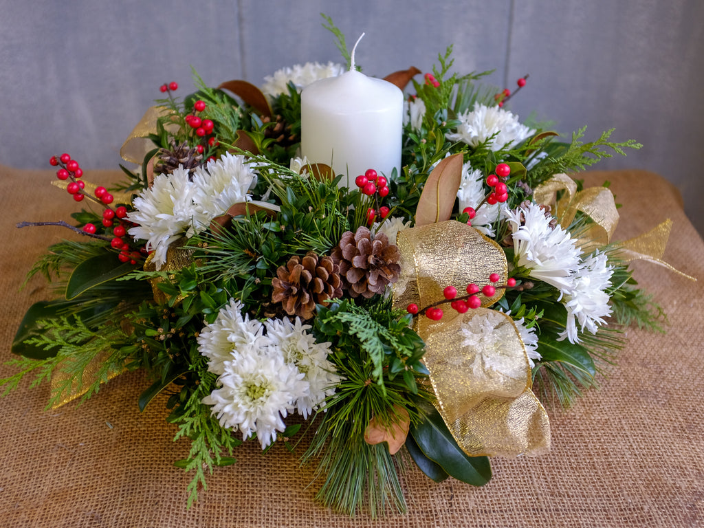Christmas Centerpieces with White Candle, Ilex, and Snowflake Mums by Michler's Florist