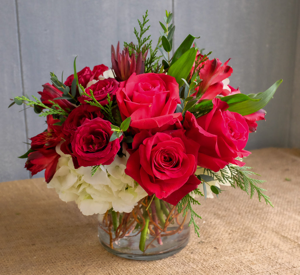 Ladybird flower bouquet, designed with red roses and hydrangea by Michler's Florist in Lexington, KY