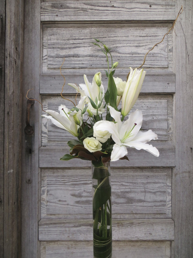 Limestone Flower Arrangement: Tall vase with white lilies and lisianthus. Designed by Michler's Florist in Lexington, KY