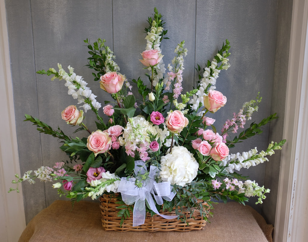 Floral basket spray with white and pink flowers