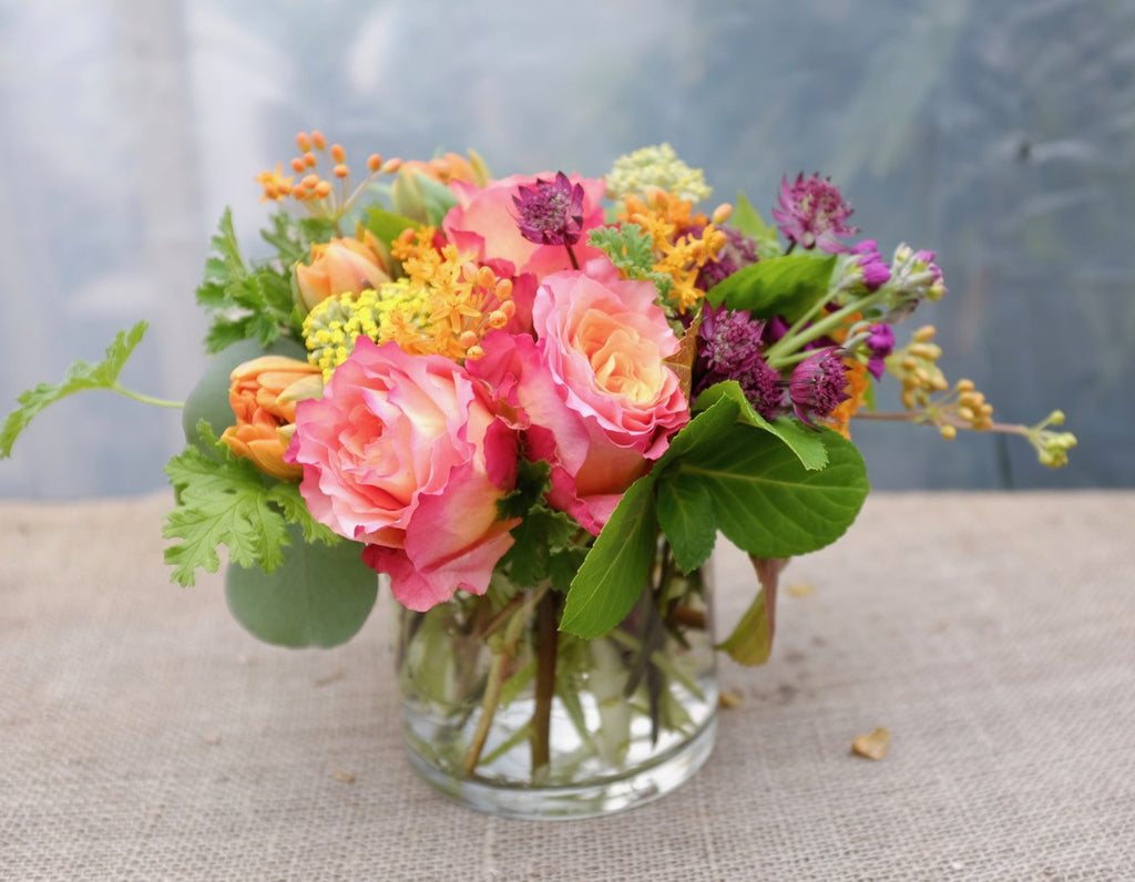 Malta: Flower Arrangement with roses, yarrow, asclepias, double tulips and astrantia | Michler's Florist